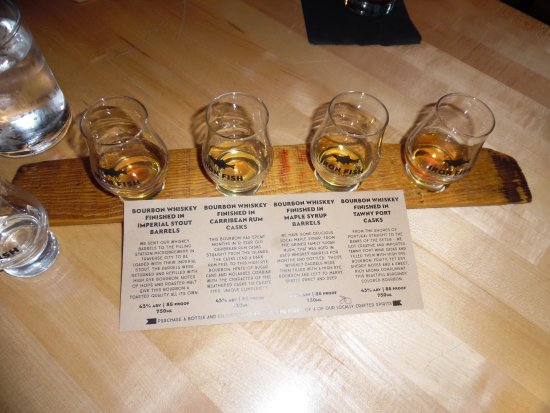 Flight of whiskey picture of iron fish distillery for Iron fish distillery