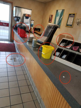 Maumelle, AR: Dirty counters, floor, boxes out front, iced tea spill