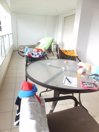 Ona Garden Lago: balcony with table chairs and sunbeds