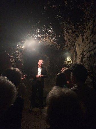 Slavonice, Česká republika: A tour of the wine cellar in the underground tunnel.
