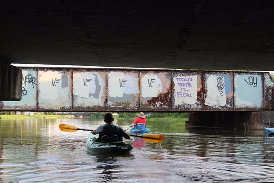 Kayak-iti-Yat Original Kayaking Tours of New Orleans: Kayak passing under the bridge