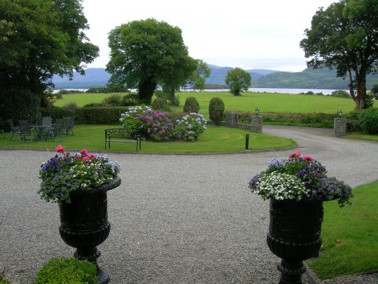 Loch Lein Country House: View of gardens/lake from front porch