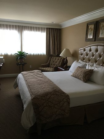 Best Western Plus Sunset Plaza Hotel Beautiful King Size Bed Lovely Reading Chair
