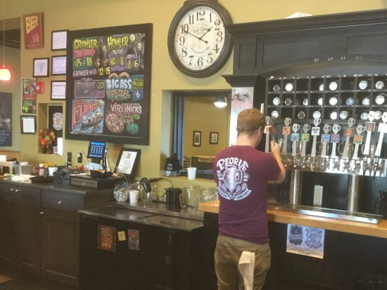 Peoria, IL: bartender with brewery shirt.