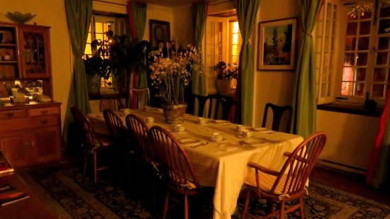 The dining area at Maison Historique James Thompson, dressed at night for tomorrow's breakfast