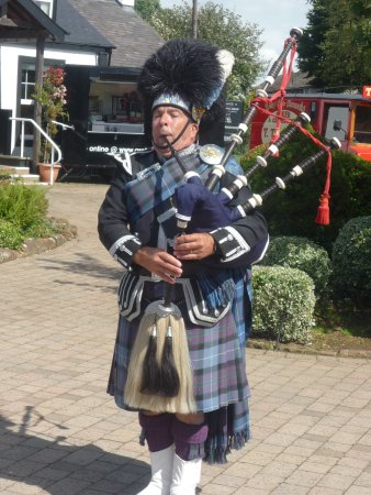 Famous Blacksmiths Shop: Piper performing in front of old Blacksmith Shop