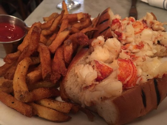 Neptune Oyster: Hot lobster roll with butter and a side of fries