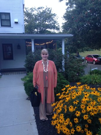Rindge, NH: Me outside Woodbound Inn, with the flowers in bloom