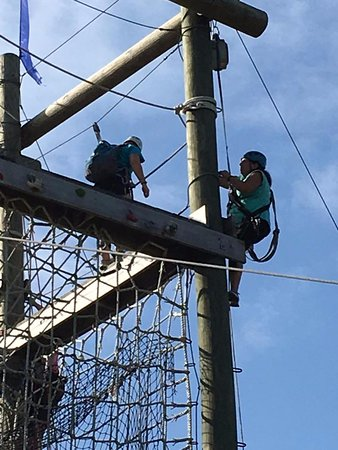 Kittery, ME: Climbing the pole to the start of the first zip.