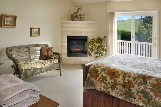 Eastlake Room Fireplace And Sliding Glass Door Onto Private Balcony