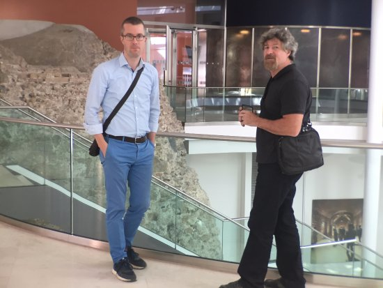 Wienguide Tours: Bernd (on left) at Palais Coburg hotel Roman wall