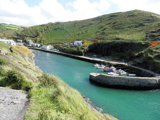 Boscastle, UK: A small fleet of fishing boats nestle in the protection of the harbour walls.