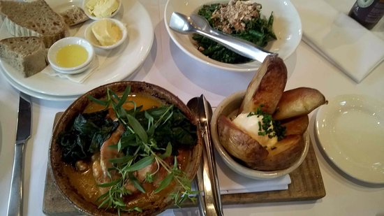 Woodstock Coterie: Sourdough bread, bowl of greens and Tarragon infused oven-oven chicken.