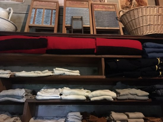 New Ulm, MN: clothing and blankets behind counter