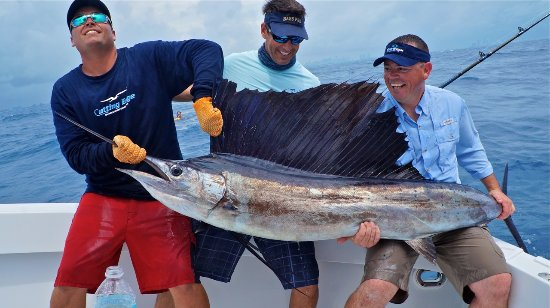 Key Biscayne, FL: Happy anglers show off the Catch with Peter Miller from TV show Bass2Billfish on the Cutting Edg