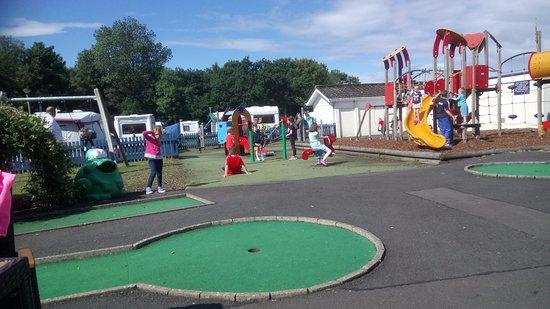 Parkdean - Sundrum Castle Holiday Park: A squint picture but shows the play park.