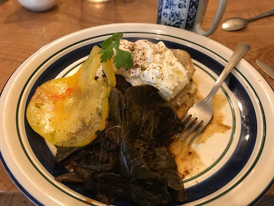 Lake Leelanau, MI: Poached eggs atop scalloped potatoes, slice of heirloom tomato, collard greens cooked with bacon