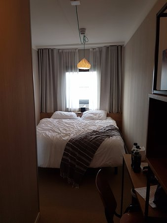 Bedroom with small window and tiny space either side of the ...