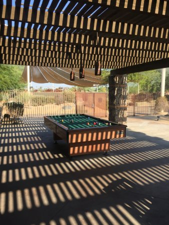 Embarc Palm Desert: Outdoor pool table with nearby misters when it is hot