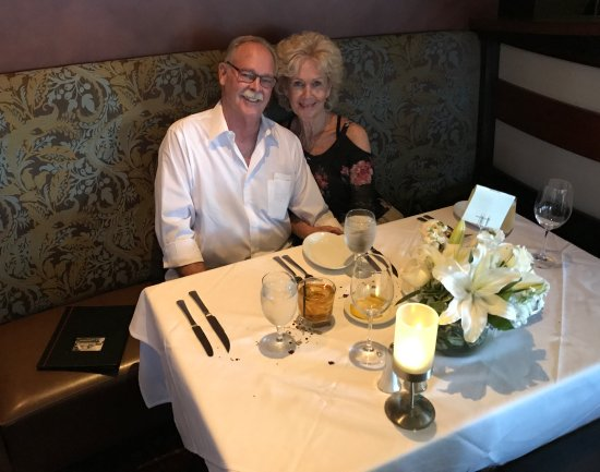 Ruth's Chris Steak House: My Birthday Girl.., Mona and I before ordering dinner. Lookie them flowers.