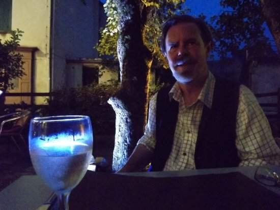 Massat, Fransa: My partner at dusk at Cafe Restaurant Le Maxil