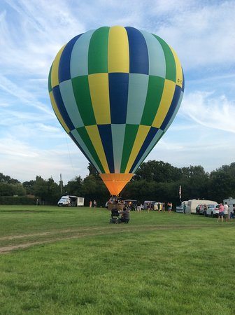 Wisborough Green, UK: Camping field in front of pub. With an occasional hot air balloon taking off !!