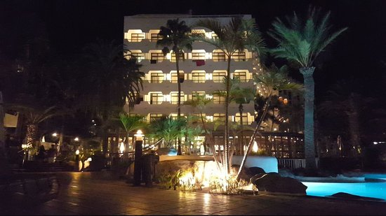 Corallium Beach By Lopesan Hotels: hotel view from pool bar at night_large.jpg