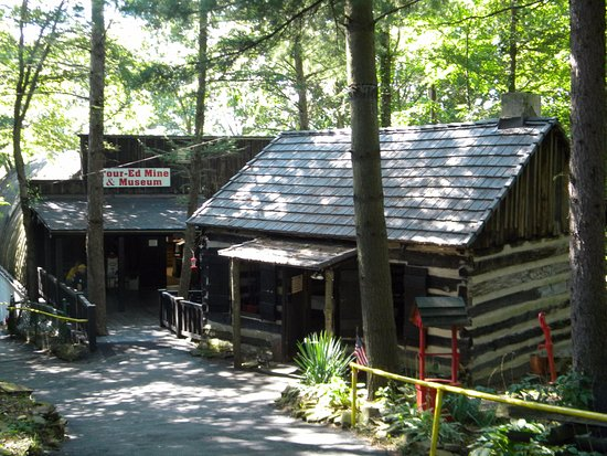 Tour-Ed Coal Mine: A real log cabin greats visitors