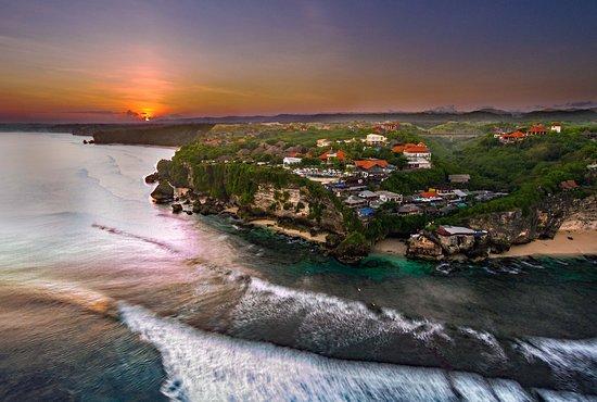 Sunrise above the Bali. Blue Point Bay Villas & Spa. hidden cave entrance & Uluwatu Beach.