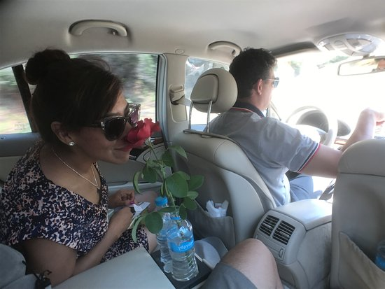George's Taxi: Kostas picked a rose from a garden (with permission from the owner) for our anniversary