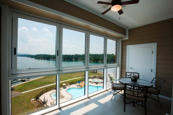 "Huddleston, VA: Our two bedroom condos have ""roll back"" windows for an open balcony or closed sunroom effect."