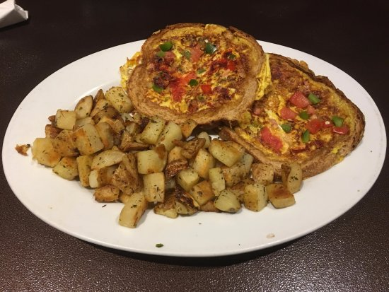 Enfield, CT: Toasted Omelet: eggs, tomatoes, and peppers scrambled & cooked inside the crust of toast.