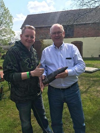 Seelow, Alemania: My son and I holding a shell from a Konigstiger in Reitwein.