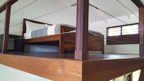 Village de Santo Resort: View of the bed on a mezzanine level.