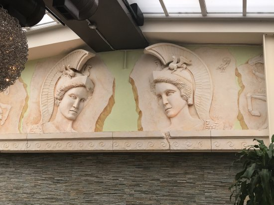 Athena Greek Restaurant : Relief sculpture of two near-mirror images of Athena, patron of Athens