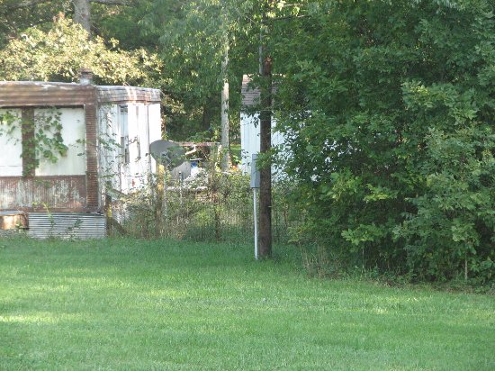 Leasburg, MO: old trailer right outside room. Could shoot this easily because the blinds were missing