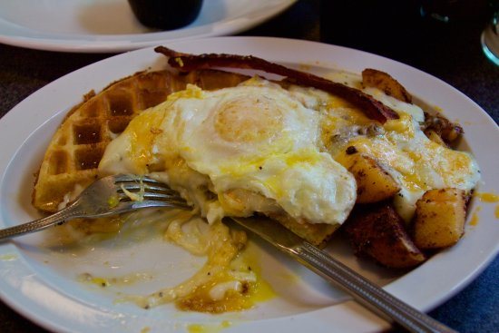 Creekside Cafe & Grill: This was my Wafflelaughagus. Waffle w/melted cheese, gravy, eggs, potatoes and bacon.
