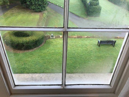 "Chapel Brampton, UK: ""Holly suite"" Mould in bathroom and front window, missing kickboard in bathroom"