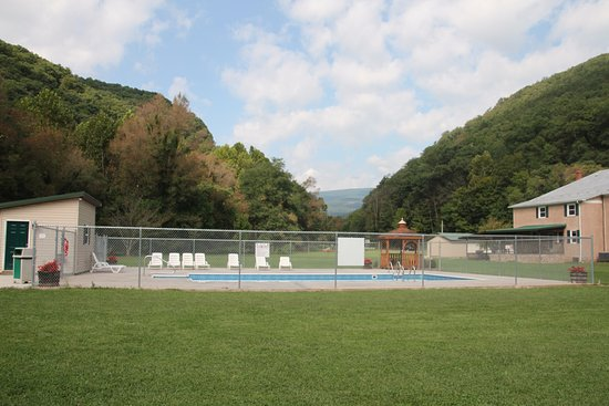 Cabins, WV: The outdoor pool adjacent to a large field