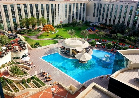 Oasis garden and pool bar picture of millennium airport for Garden pool dubai