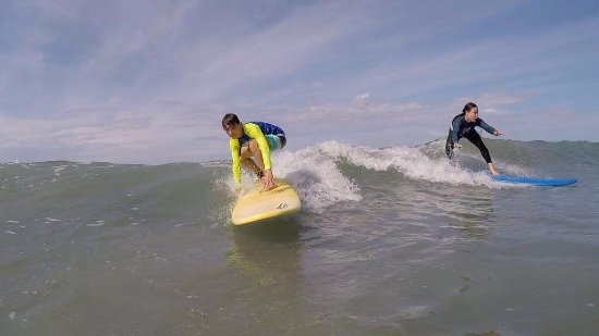 Quepos, Costa Rica: a both ways waves being ridden by this siblings im Espadilla beach, Manuel Antonio.