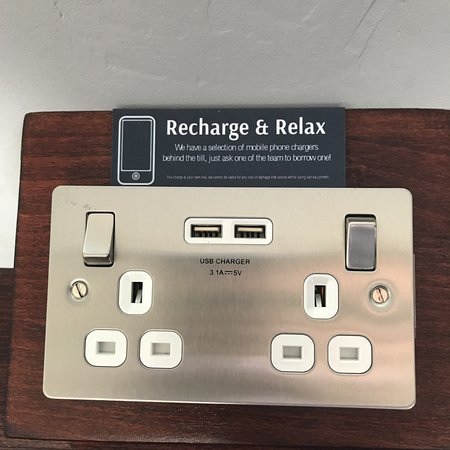 Lots of phone chargers to borrow behind the counter with
