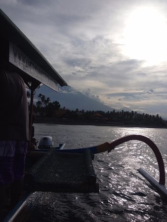 Amed, Indonesia: A Jukung boat with a view of Mt Agung.