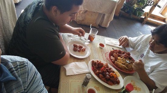 Bayview Szechuan & Chinese Restaurant : Wife with her platter and our son with the sweet and sour pork