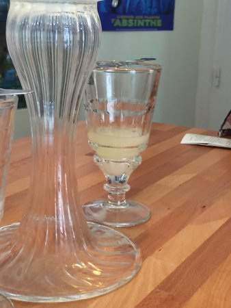 Musée de l'absinthe : Glass of absinthe and fountain.