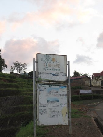 Gisakura, Rwanda: The sign on the main road... keep a sharp eye, or else you'll miss it!