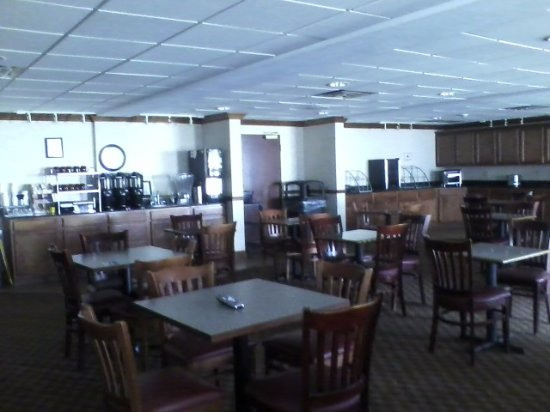 Hawthorn Suites by Wyndham Charleston: large dining area with a tv on in the mornings