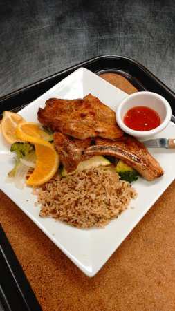 Caldwell, TX: Grilled Pork Chops w/cajun rice, grilled veggies and a salad. You can get them lunch or dinner!