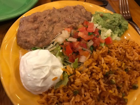 El Gato Negro Mexican Restaurant: Chicken fajitas with red and green peppers, onions, as well as grilled Mexican squash, Brussel s