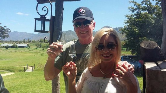 Stanford, South Africa: Two of the owners, Mike and Gigi having a great day with Scattered links bike group.